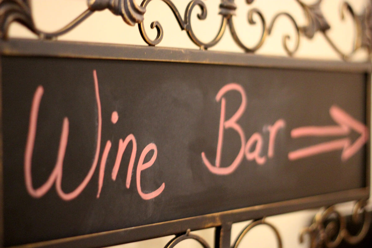 "Picture of a chalkboard sign with the words ""Wine Bar"" written on it, at Latte Da in Vancouver WA"